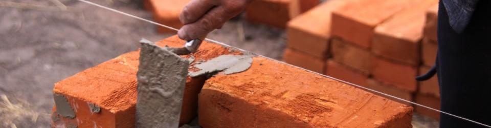 Man Building Brick Wall 1259651422 861 960x250