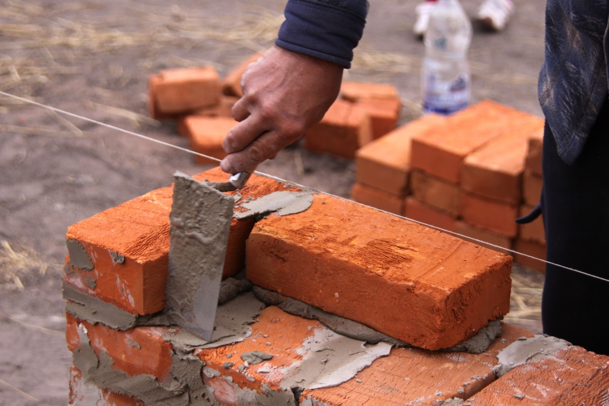 Man Building Brick Wall 1259651422 861